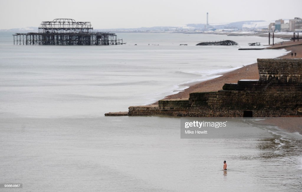 A hardy soul goes for a swim in the sea, the water temperature being 3.9 degrees C on January 9, 2010 in Brighton, England.