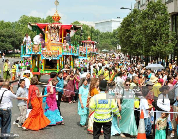 Hare Krishna devotees help to pull three giant decorative wheeled shrines from Hyde Park to Trafalgar Square to celebrate the 'Rathayatra' Festival