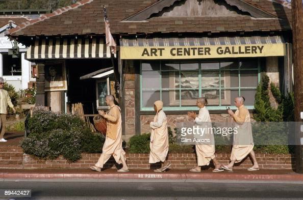 A Hare Krishna procession passes the Art Center Gallery in Laguna Beach California January 1970