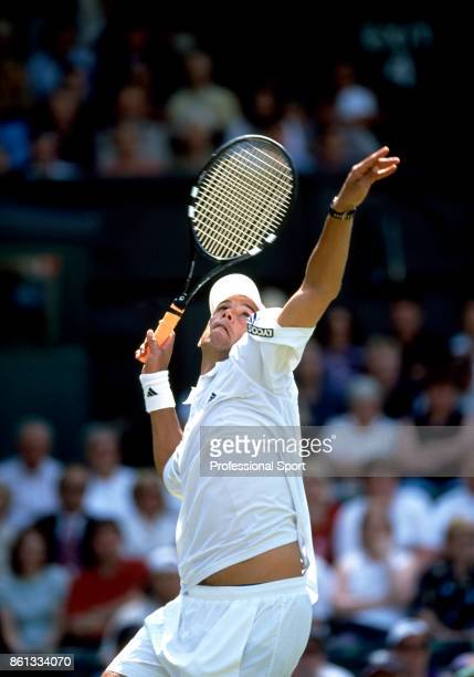 Harel Levy of Israel in action against Andre Agassi of the USA in their mens singles first round match during the Wimbledon Lawn Tennis Championships...