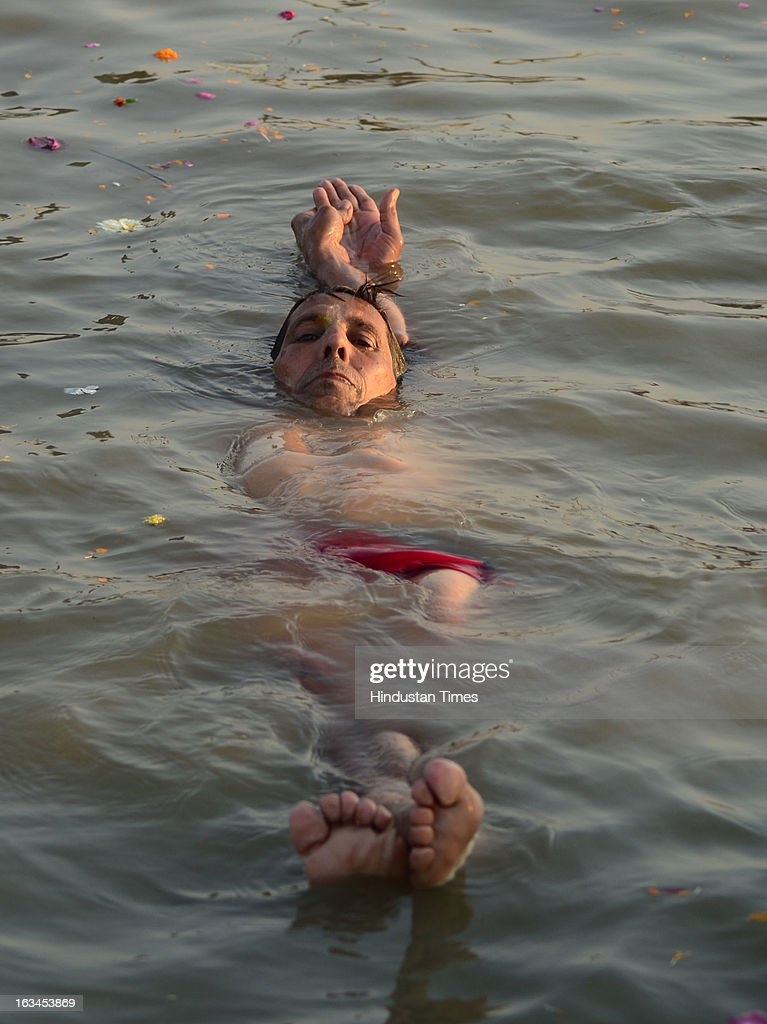 Haresh Chaturvedi performing water Yoga at Sangam on Mahashivratri Snan, in a Kumbh Mela area, on March 10, 2013 in Allahabad, India. The snan marked conclusion of the 55-day Mahakumbh during which around 8 crore pilgrims took the holy dip in the Sangam waters.