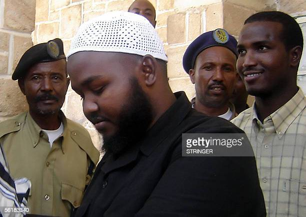 Sheick Abdurhaman Indhade leader of the group of eight men who allegedly shot foreign aid workers in Somaliland in March 2004 is escorted 14 November...