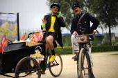 Haribo and postman performers pose on July 9 2010 prior to the start of the 2275 km and 6th stage of the 2010 Tour de France cycling race run between...