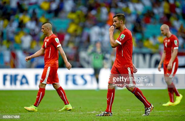 Haris Seferovic and Switzerland players walk off the pitch after the first half during the 2014 FIFA World Cup Brazil Group E match between...
