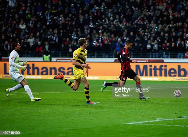 Haris Seferovic of Eintracht Frankfurt scores their second goal past Roman Weidenfeller and Matthias Ginter of Borussia Dortmund during the...