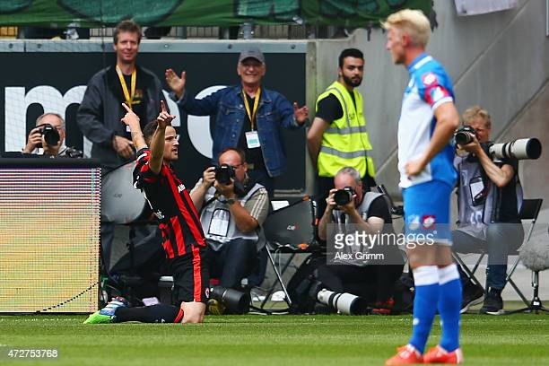 Haris Seferovic of Frankfurt celebrates her team's second goal as Andreas Beck of Hoffenheim reactsduring the Bundesliga match between Eintracht...