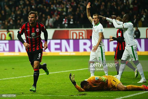Haris Seferovic of Frankfurt celebrates his team's second goal as goalkeeper Raphael Wolf of Bremen lies on the ground during the Bundesliga match...