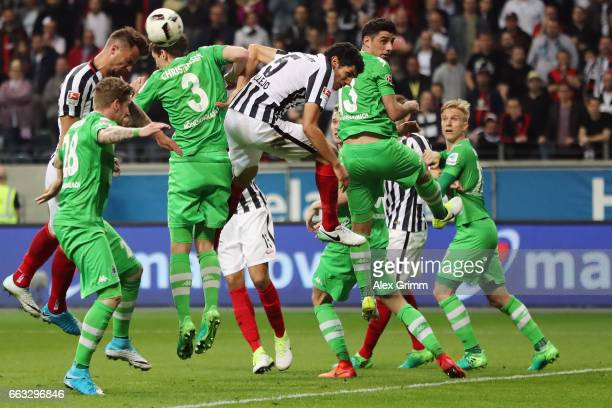 Haris Seferovic of Frankfurt jumps for a header with Andreas Christensen of Moenchengladbach during the Bundesliga match between Eintracht Frankfurt...