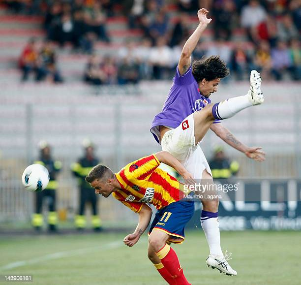 Haris Seferovic of Lecce competes for the ball with Felipe Dias da Silva Dalbelo of Fiorentina during the Serie A match between US Lecce and ACF...