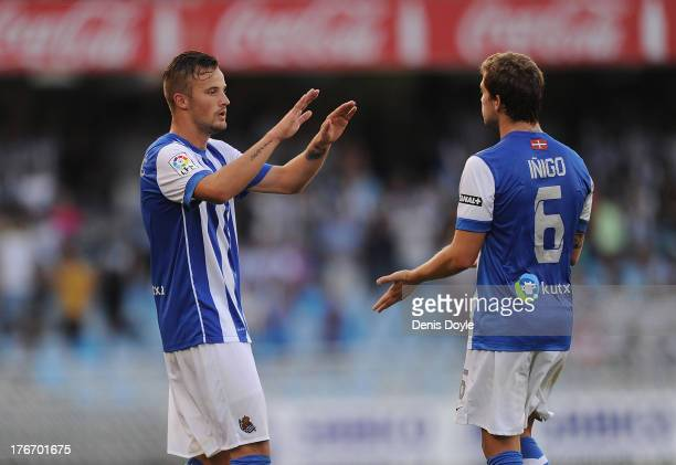 Haris Seferovic of Real Sociedad celebrates with Inigo Martinez after scoring his team's 2nd goal during the La Liga match between Real Sociedad and...