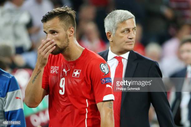 Haris Seferovic of Switzerland and coach Vladimir Petkovic show their disappointment during the EURO 2016 Qualifier match between Switzerland and...