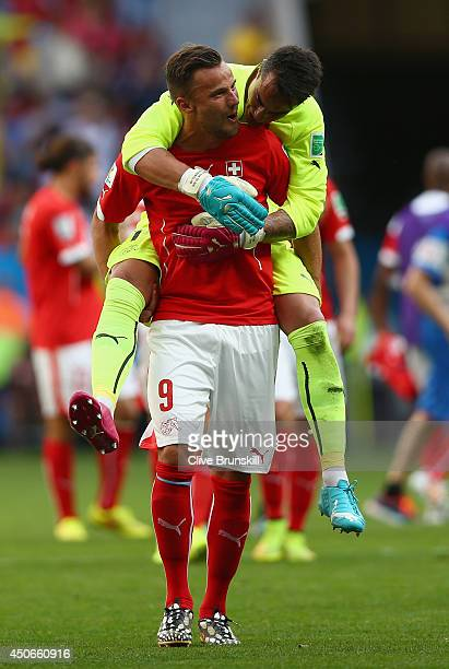 Haris Seferovic of Switzerland celebrates with goalkeeper Diego Benaglio after defeating Ecuador 21 during the 2014 FIFA World Cup Brazil Group E...