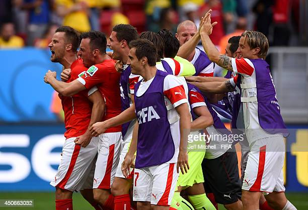 Haris Seferovic of Switzerland celebrates with teammates after the 2014 FIFA World Cup Brazil Group E match between Switzerland and Ecuador at...
