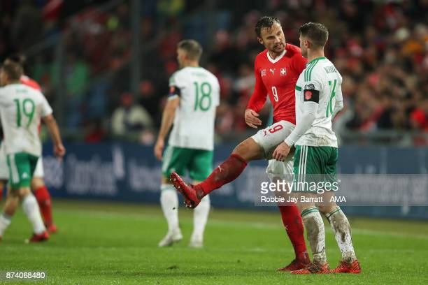 Haris Seferovic of Switzerland gestures towards Oliver Norwood of Northern Ireland during the FIFA 2018 World Cup Qualifier PlayOff Second Leg...
