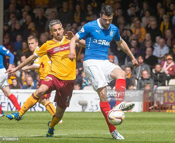 Haris Vuckic of Rangers competes with Keith Lasley of Motherwell during the Scottish Premiership playoff final 2nd leg between Motherwell and Rangers...