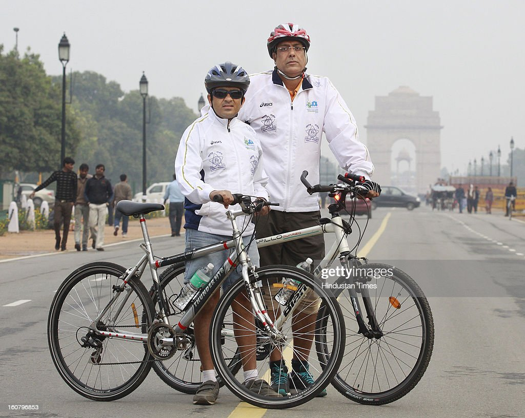 Harish Baijal (L) Deputy Commissioner of Police, Nasik with Harshad Purnapatre ( R) standing with their bicycles at India Gate on February 5, 2012 in New Delhi, India. They will cycle from India Gate in New Delhi to Gateway Of India in Mumbai to mark the 150 years of Indian Police. Imperial Police Service was formed in 1893 and was later replaced with Indian Police Service after Independence in 1948.