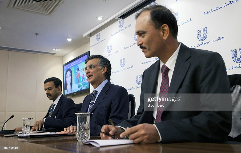 Harish Manwani, chairman of Hindustan Unilever Ltd. and chief operating officer of Unilever NV, center, speaks as Sridhar Ramamurthy, chief financial officer of Hindustan Unilever Ltd., left, and Nitin Paranjpe, managing director and chief executive officer of Hindustan Unilever Ltd., listen during Hindustan Unilever Ltd.'s earnings news conference in Mumbai, India, on Monday, April 29, 2013. Hindustan Unilever, the Indian unit of the world's second-biggest consumer-goods company, rose the most in nine months in Mumbai trading after fourth-quarter profit beat analysts estimates. Photographer: Kuni Takahashi/Bloomberg via Getty Images