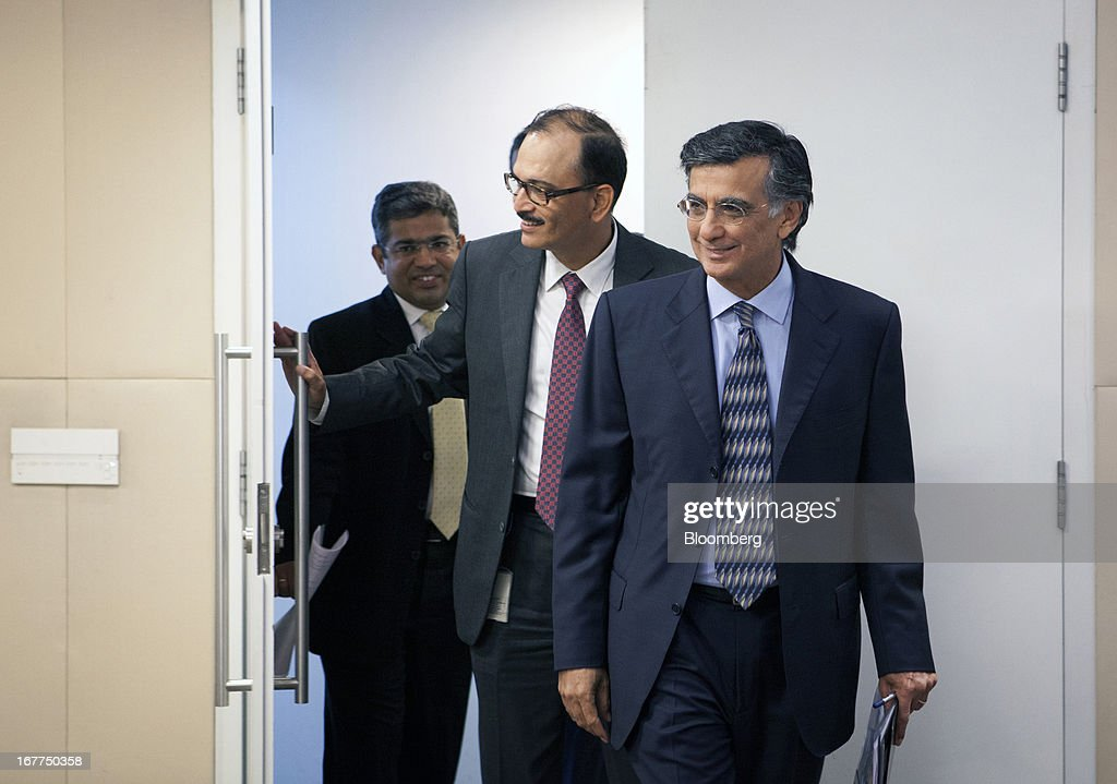 Harish Manwani, chairman of Hindustan Unilever Ltd. and chief operating officer of Unilever NV, right, and Nitin Paranjpe, managing director and chief executive officer of Hindustan Unilever Ltd., center, enter the room prior to Hindustan Unilever Ltd.'s earnings news conference in Mumbai, India, on Monday, April 29, 2013. Hindustan Unilever, the Indian unit of the world's second-biggest consumer-goods company, rose the most in nine months in Mumbai trading after fourth-quarter profit beat analysts estimates. Photographer: Kuni Takahashi/Bloomberg via Getty Images