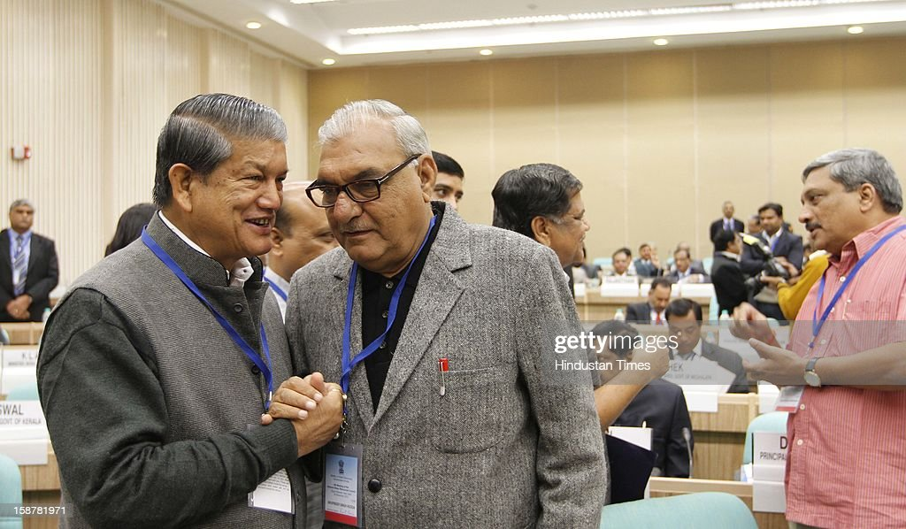 Harish Rawat Union minister for Water Resources with Haryana Chief Minister BS Hooda at the Sixth Meeting of the National Water Resources Council, at Vigyan Bhawan on December 28, 2012 in New Delhi, India.