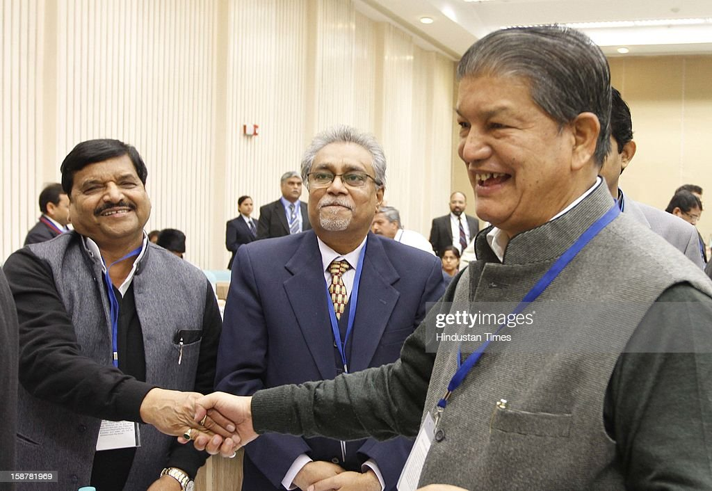 Harish Rawat Union minister for Water Resources with Shiv Pal Singh Yadav PWD and Water Resources minister of Uttar Pradesh Govt at the Sixth Meeting of the National Water Resources Council, at Vigyan Bhawan on December 28, 2012 in New Delhi, India.