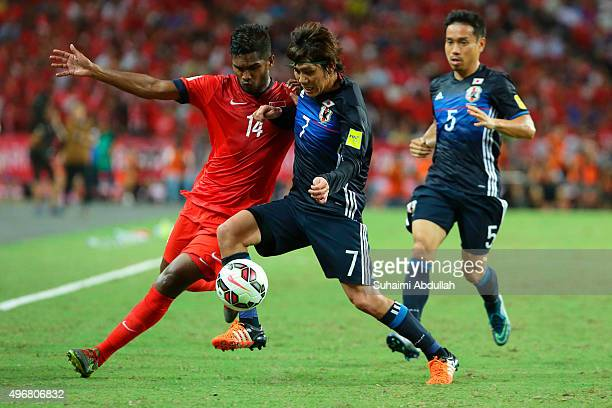 Hariss Harun of Singapore and Kashiwagi Yosuke of japan challenge for the ball during the 2018 FIFA World Cup Qualifier match between Singapore and...