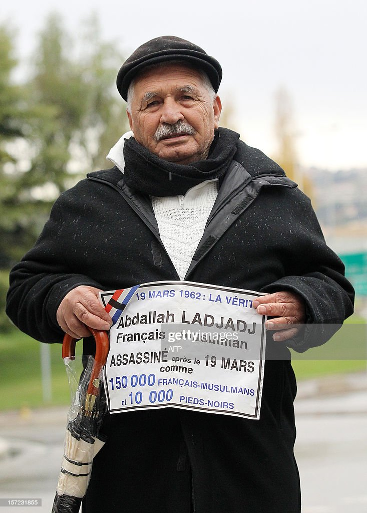 A Harki, an Algerian who fought beside the French Army during the Algerian War that led to independence, holds banners with the name of a fighter killed after March 19, 1962 as he protests with Pied-Noirs (Black-Foots), French citizens who lived in French Algeria before it's independence, on November 30, 2012 in Nice, Southern France, in front of the Alpes-Maritimes administrative centre against a draft law officializing March 19, the anniversary date of the Algerian War 1962 ceasefire, as a 'national day of memory' in memory of war's victims. The Constitutional Council of France ruled on November 29 that the law complied with the constitution.