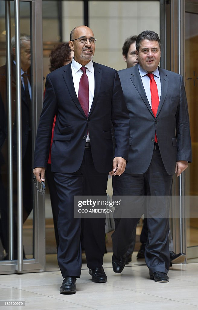 Harlem Desir, First Secretary of the French Socialist Party (PS) (L) and his counterpart Sigmar Gabriel (R) of the German Social Democratic Party (SPD) arrive for a joint press conference on October 24, 2013 at the party's headquarter Willi-Brandt-House in Berlin, Germany, following talks on a further cooperation regarding the 2014 European elections.