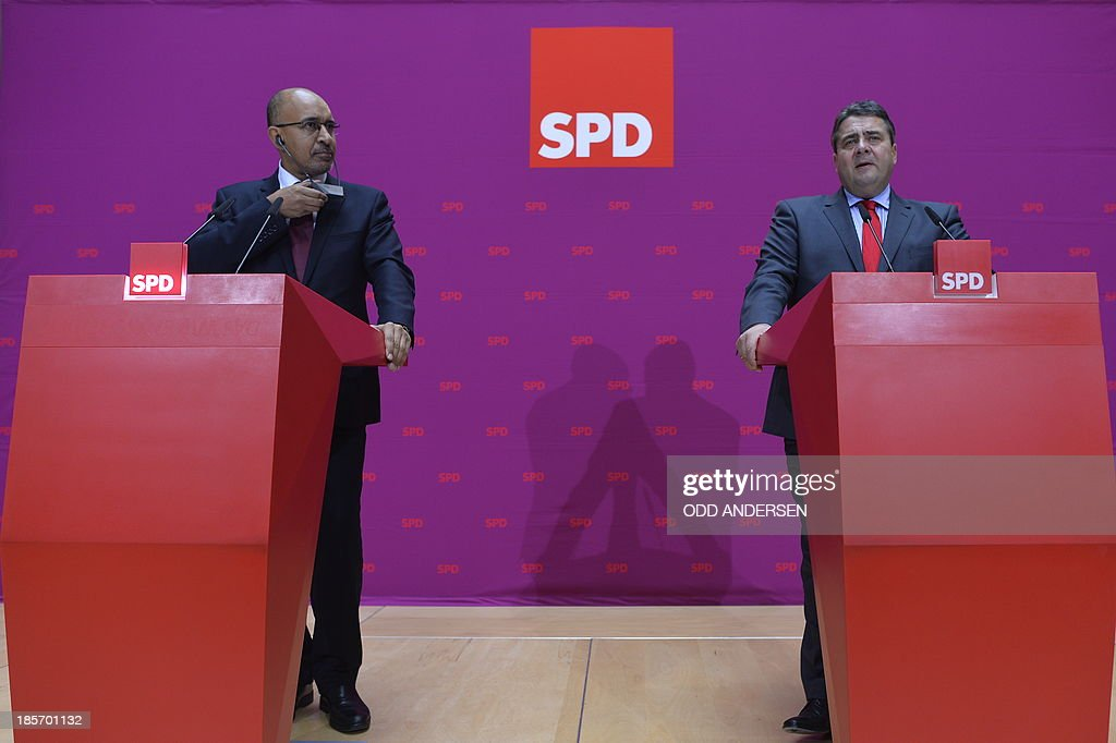 Harlem Desir, First Secretary of the French Socialist Party (PS) (L) and his counterpart Sigmar Gabriel (R) of the German Social Democratic Party (SPD) address a joint press conference on October 24, 2013 in Berlin, following talks on a further cooperation regarding the 2014 European elections.
