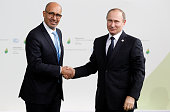 Harlem Desir French Minister of State for European affairs welcomes Russian President Vladimir Putin as he arrives for the COP21 United Nations...