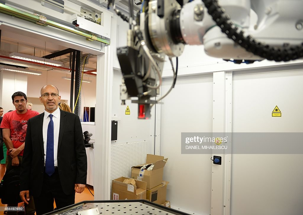 Harlem Desir (2nd,L), State Secretary for European Affairs at the French Ministry of Foreign Affairs visits the International Development Center for Advanced Technology Laser (CETAL) a company that has developed the most powerful laser in the world in Magurele village, south of Bucharest September 2, 2014.