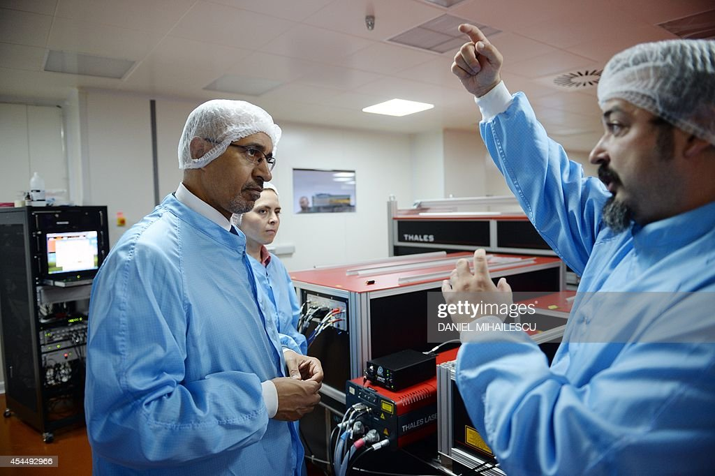 Harlem Desir (L), State Secretary for European Affairs at the French Ministry of Foreign Affairs visits the International Development Center for Advanced Technology Laser (CETAL) a company that has developed the most powerful laser in the world in Magurele village, south of Bucharest September 2, 2014.
