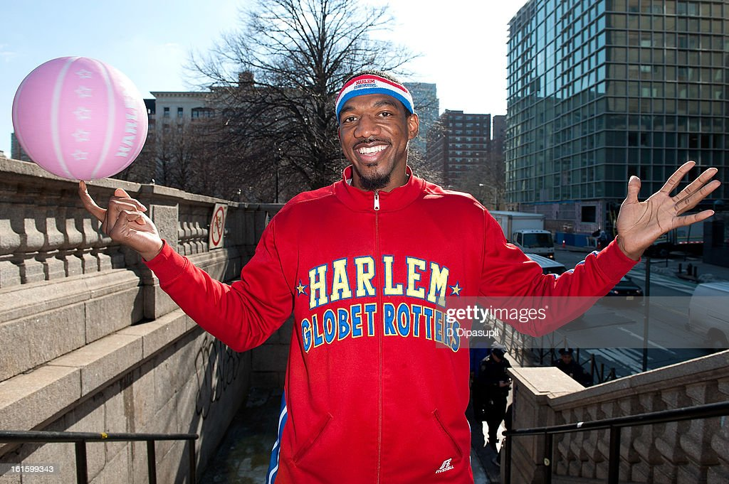 Harlem Globe Trotter Anthony 'Buckets' Blakes dribbles from Brooklyn to Manhattan at the Manhattan Bridge on February 12, 2013 in New York City.