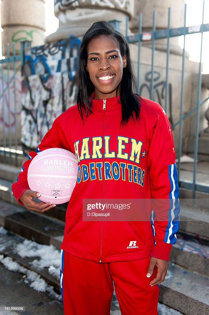 Harlem Globe Trotter Fatima 'TNT' Maddox dribbles from Brooklyn to Manhattan at the Manhattan Bridge on February 12, 2013 in New York City.