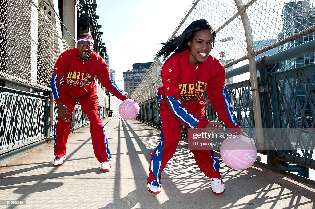 Harlem Globe Trotters Fatima 'TNT' Maddox (R) and Anthony 'Buckets' Blakes dribble from Brooklyn to Manhattan at the Manhattan Bridge on February 12, 2013 in New York City.