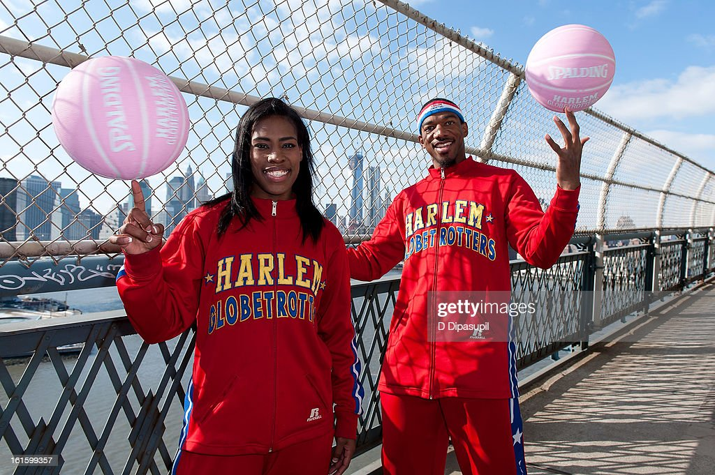 Harlem Globe Trotters Fatima 'TNT' Maddox (L) and Anthony 'Buckets' Blakes dribble from Brooklyn to Manhattan at the Manhattan Bridge on February 12, 2013 in New York City.