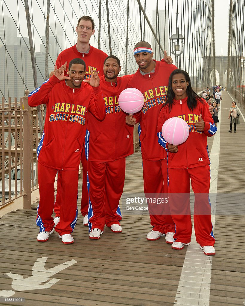 Harlem Globetrotters Cheese Chisholm, Tiny Sturgess, Handles Franklin, Hammer Harrison and TNT Maddox attend The Harlem Globetrotters Dribble Across The Brooklyn Bridge To Celebrate Their Upcoming Game At The Barclays Center on October 3, 2012 in New York City.
