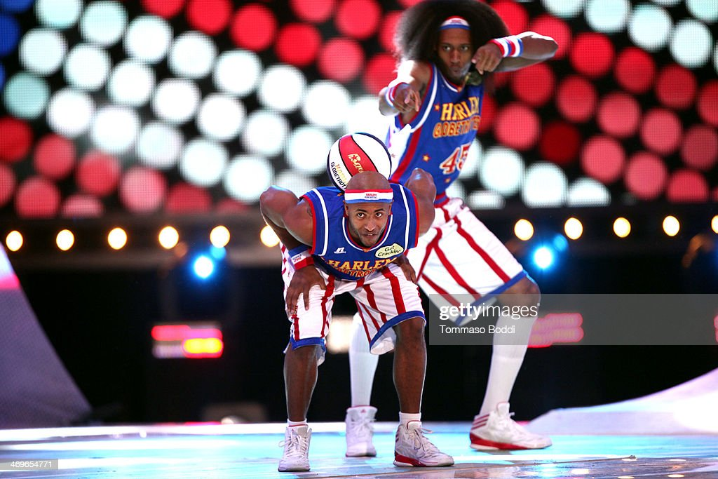 Harlem Globetrotters Dizzy (L) and Moose perform onstage during the 4th Annual Cartoon Network Hall Of Game Awards held at the Barker Hangar on February 15, 2014 in Santa Monica, California.
