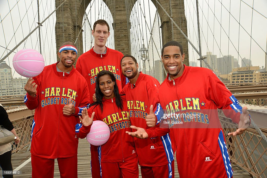 Harlem Globetrotters Hammer Harrison, Tiny Sturgess, TNT Maddox, Handles Franklin and Cheese Chisholm attend The Harlem Globetrotters Dribble Across The Brooklyn Bridge To Celebrate Their Upcoming Game At The Barclays Center on October 3, 2012 in New York City.