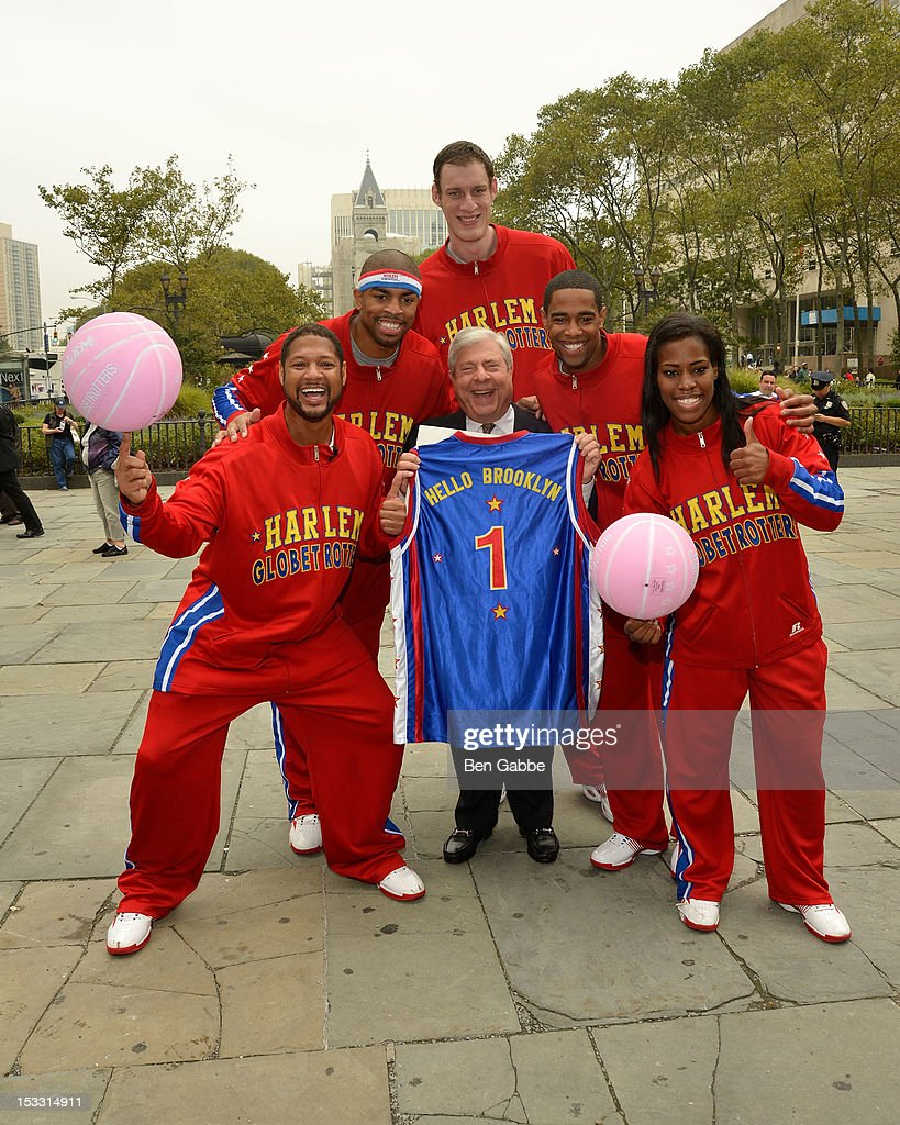 Harlem Globetrotters Handles Franklin, Hammer Harrison, Tiny Sturgess, Cheese Chisholm and TNT Maddox with (C) Brooklyn Borough President Marty Markowitz attend The Harlem Globetrotters Dribble Across The Brooklyn Bridge To Celebrate Their Upcoming Game At The Barclays Center on October 3, 2012 in New York City.