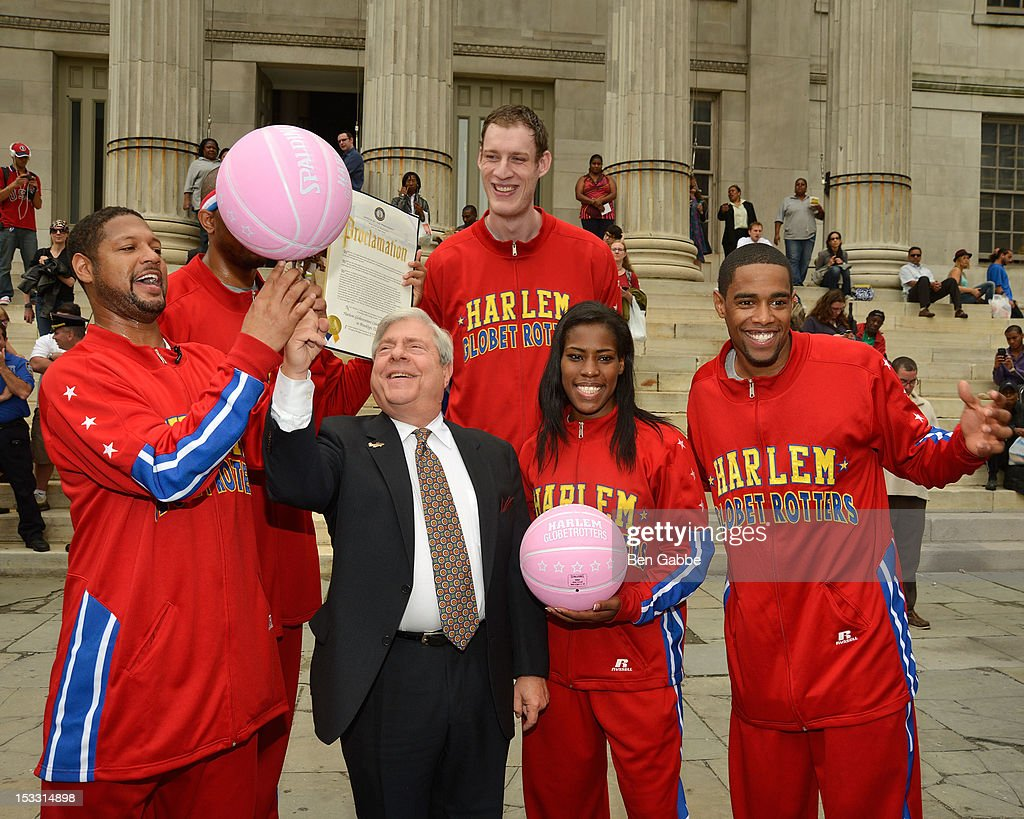 Harlem Globetrotters Handles Franklin, Tiny Sturgess, TNT Maddox and Cheese Chisholm with (C) Brooklyn Borough President Marty Markowitz attend The Harlem Globetrotters Dribble Across The Brooklyn Bridge To Celebrate Their Upcoming Game At The Barclays Center on October 3, 2012 in New York City.