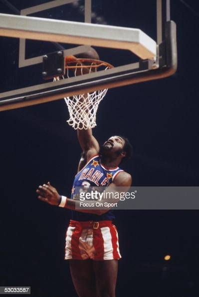 Harlem Globetrotters player dunks during a game