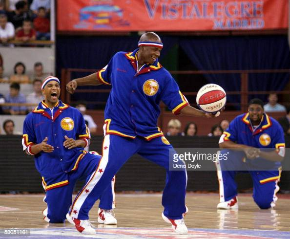 Harlem Globetrotters players warm up for their match against the New York Nationals on June 10 2005 at the Vistalegre Stadium in Madrid Spain