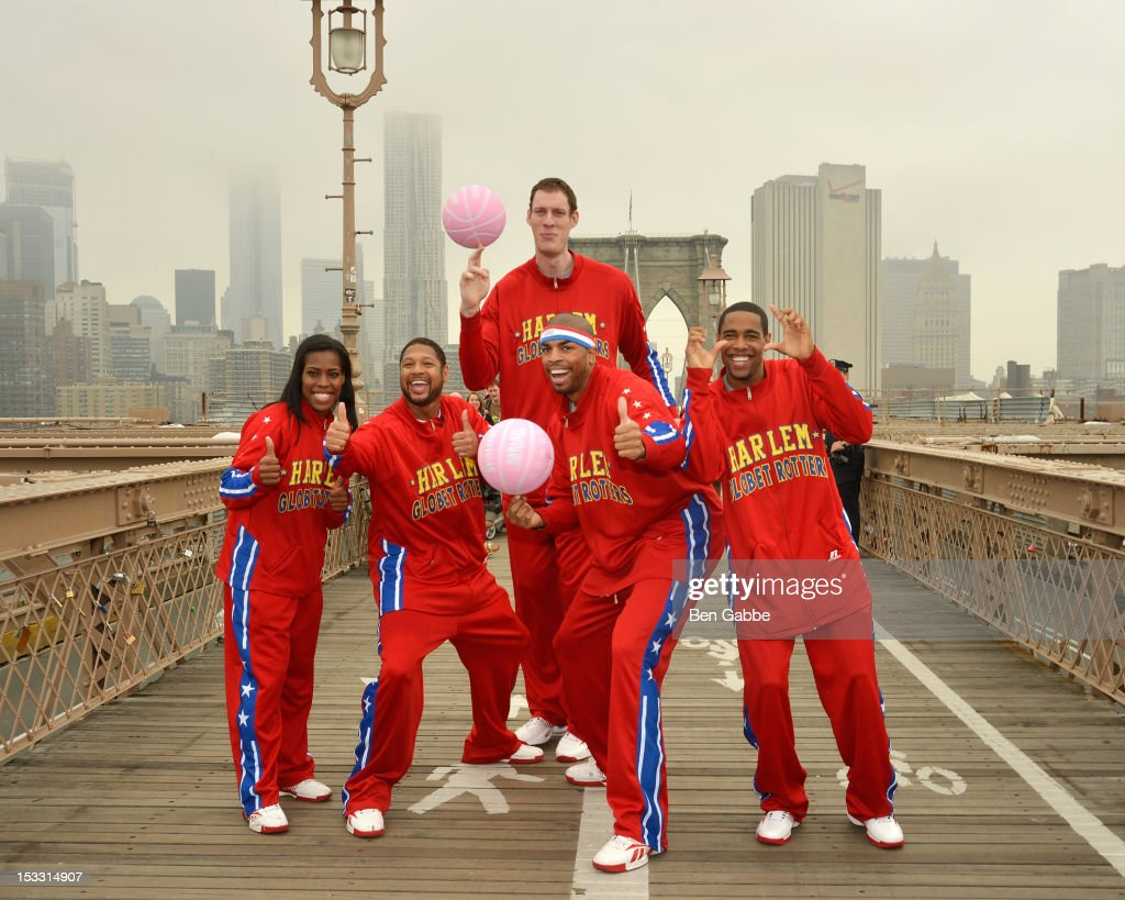 Harlem Globetrotters TNT Maddox, Handles Franklin, Tiny Sturgess, Cheese Chisholm and Hammer Harrison attend The Harlem Globetrotters Dribble Across The Brooklyn Bridge To Celebrate Their Upcoming Game At The Barclays Center on October 3, 2012 in New York City.