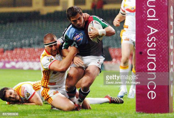 Harlequins' Chad Randall breaks through the tackles of Catalan Dragons' Cyrille Gossard and Jerome Guisset to score under the posts during the Engage...