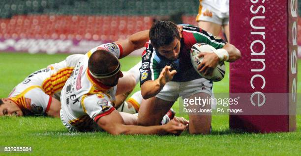 Harlequins' Chad Randall scores under the posts despite the tackles of Catalan Dragons Cyrille Gossard and Jerome Guisset during the Engage Super...
