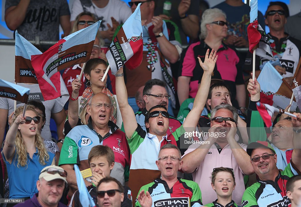 A Harlequins fan celebrates a try during the Aviva Premiership semi final match between Saracens and Harlequins at Allianz Park on May 17, 2014 in Barnet, England.