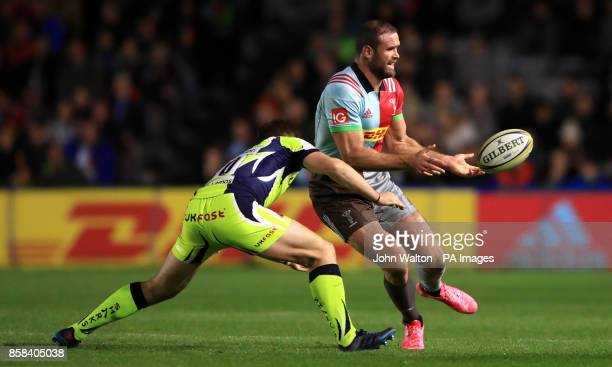 Harlequins' Jamie Roberts is tackled by Sale Sharks' Aj MacGinty during the Aviva Premiership match at Twickenham Stoop London