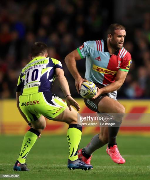 Harlequins' Jamie Roberts runs toward Sale Sharks's Aj MacGinty during the Aviva Premiership match at Twickenham Stoop London