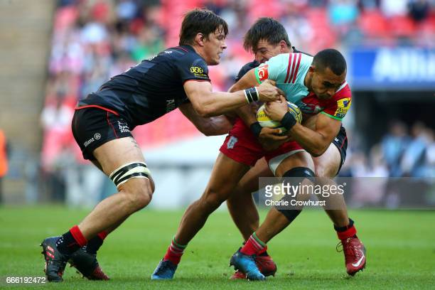 Harlequins Joe Marchant looks to break the Saracens tackle from Michael Rhodes and Schalk Brits during the Aviva Premiership match between Saracens...