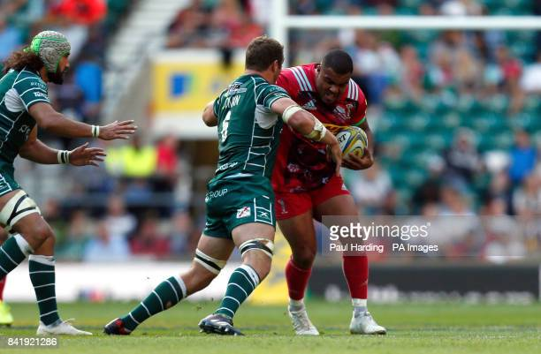 Harlequin's Kyle Sinckler is tackled by London Irish's Mike Coman during the Aviva Premiership match at Twickenham Stadium London